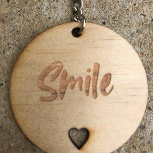 Smile wooden keyring.