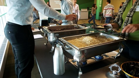 A group of people that are serving themselves rice and beans at the Oxfam Hunger Banquet on Nov. 7, 2014.