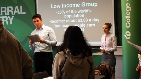Paul Jozwik (Left) speaking to the attendants at the Oxfam Hunger Banquet with Alyssa Gibbas (Right) helping on Nov. 7, 2014.