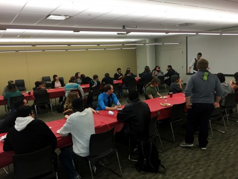 Pride Alliance member Austin Grissom explains the basics of speed dating at the College of DuPage on Feb 13.