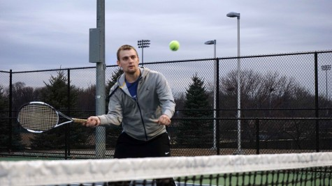 Rimas Barsketis taking a volley at practice at the tennis courts of the College of DuPage on March 19.