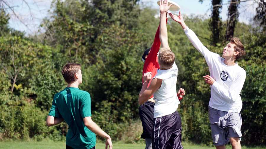 A+group+of+players+jump+for+the+disc+during+an+Ultimate+Frisbee+game+at+Knock+Knolls+Park+in+Naperville%2C+Ill+on+Sept.+12.+