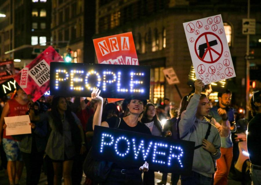 People+rallying+for+stricter+gun+control+in+the+streets+of+Las+Vegas+after+the+shooting+incident