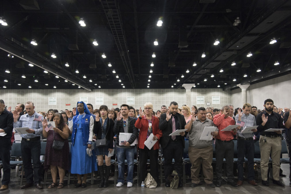 LOS ANGELES, CA | April 17, 2018 The newest U.S. citizens raise their right hands and take an oath during a Naturalization Ceremony at the Los Angeles Convention Center on April 17, 2018. Over 7,100 people from over 100 different countries were naturalized today - 32 percent were from Mexico. (Melissa Lyttle for Reveal)
