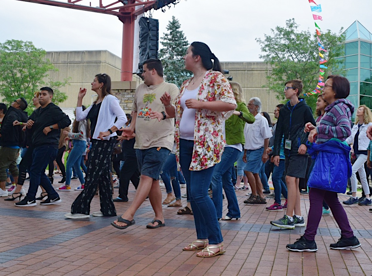 Attendees+learning+how+to+dance+salsa+in+the+pavilion.