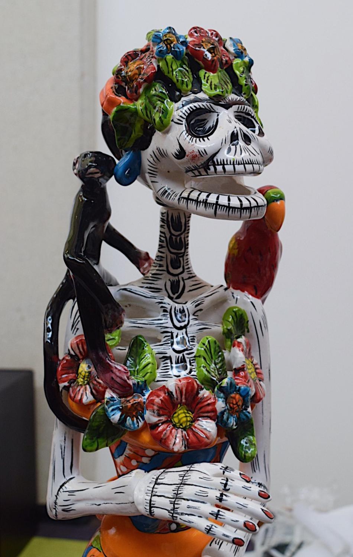 A+handmade+Frida+Kahlo+sugar+skull+statue+displayed+for+sale.