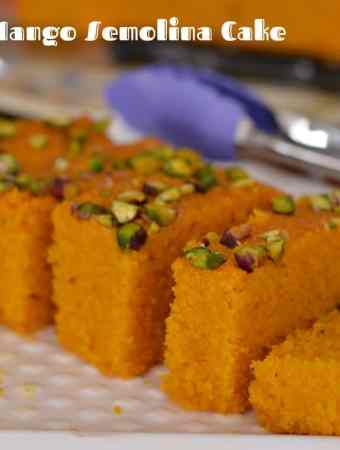 Eggless mango semolina cake is super easy to prepare. This cake is moist, dense in texture and so aromatic with its delicious mango flavor. Mango pulp folded with semolina,cardamom, and few handful nuts gives you chewy experience with every bite. A perfectcake to bake in mango season and you can never go wrong with it.