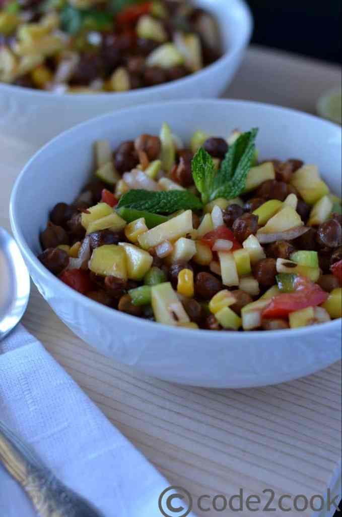 This healthy and colorful kala chana salad or black chickpea salad is full of many flavors one can think of. It is a meal in itself with loaded nutrients. Having tangy raw mango pieces, crunchy veggies, and spicy chili gives a yummy taste altogether in this salad recipe. Kala chana salad is full of protein, glutenfree, healthy and colorful to eat. You can add paneer or tofu also to make it more nutritious otherwise this salad goes in the vegan category too.