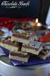 Chocolate burfi is one of the popular Indian festival sweet prepared during Diwali. It is a khoya burfi or mawa burfi recipe. Chocolate burfi is two layered burfi recipe, where the bottom layer is plain mawa layer and the top layer is chocolate flavored.