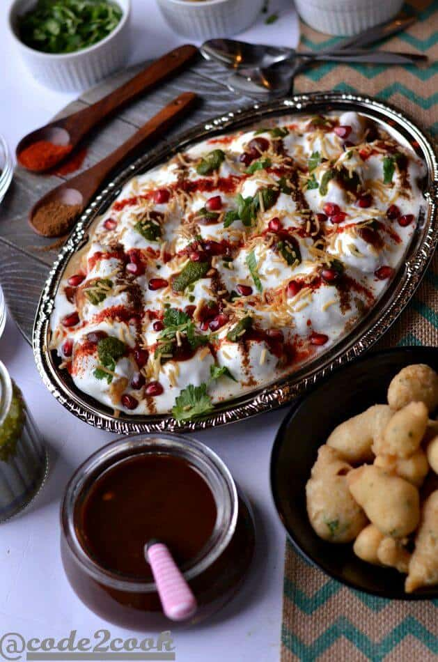 Moong dal dahi vada is a light and delicious Indian street food (Indian chat recipe) made with yellow lentil. Moong dal vadas are deep fried lentil dumplings, soaked in salty water and then served with beaten curd, green chutney, and sweet tamarind chutney.A perfect snack recipe for evening snacks or special occasions or festivals like Holi, Diwali.