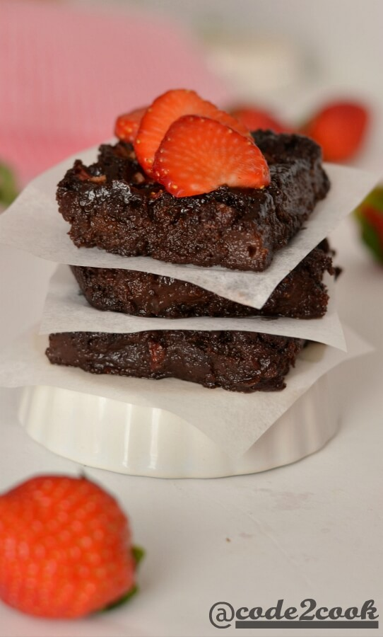 Eggless strawberry brownie is a sweet, tangy, and chocolate flavored fudge brownie for Valentine's day but can be made on any occasion. Basically, it is kind of chocolate covered strawberries in fudgy brownie form. Eggless Strawberry brownie is easy to make brownie recipe with healthy ingredients and fresh strawberries. It is best served with vanilla ice cream or whippedcream or just sliced strawberries.