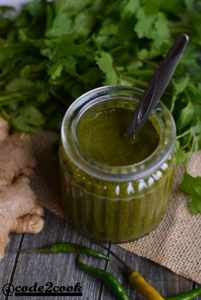 green chutney for chaat is served in glass jar. hari chutney