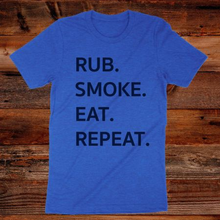Heathered blue short sleeved tshirt with the words RUB SMOKE EAT REPEAT in large black font