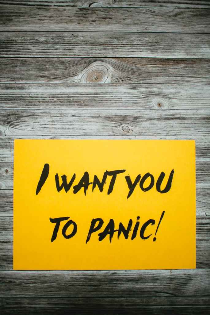 i want you to panic text on paper against wooden background