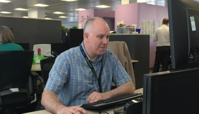 Adrian at his desk