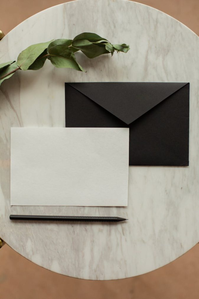 blank letter paper with envelope near dried sprig