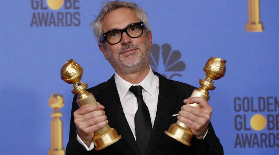 Alfonso Cuarón con sus globos de oro