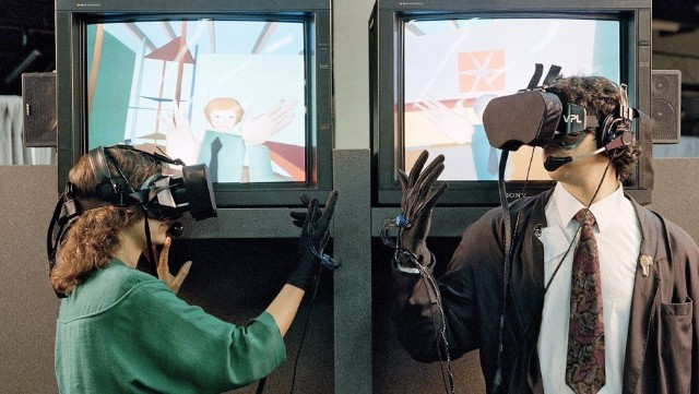 Hombre y mujer conectados al Eyephone de VPL Research 1989