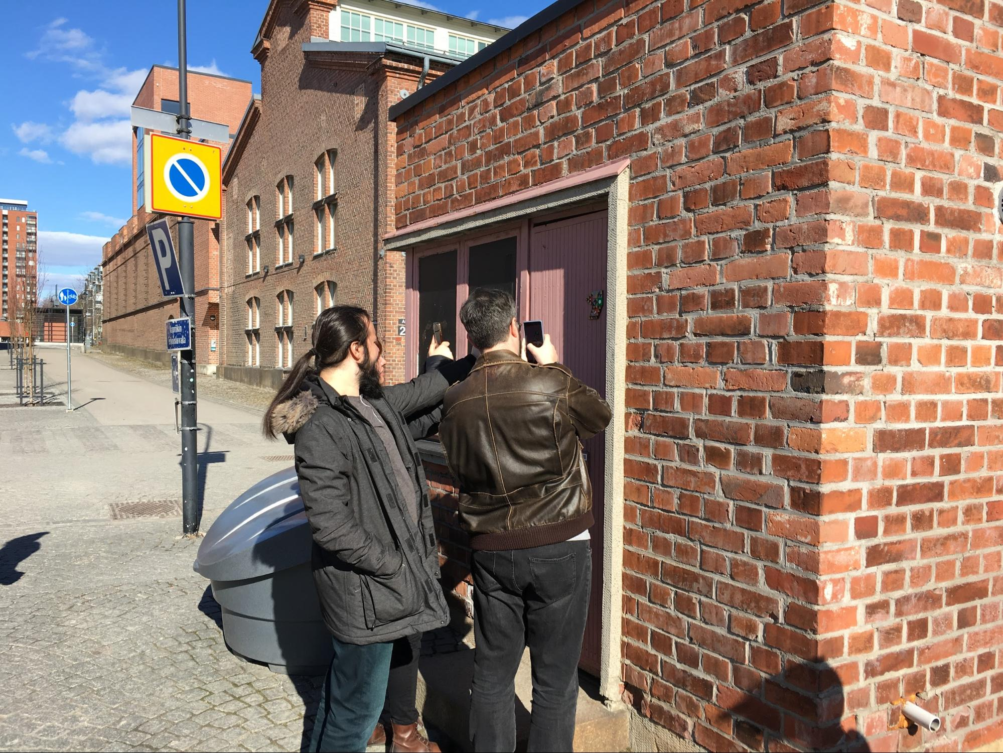 Walking tour participants scan the first code at Vapriikki museum