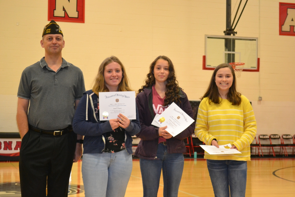 CBNA Voice of Democracy presentation (left to right) Mr. Daniel Barnhart of Northwood VFW with first place winner Sarah Marsh, third place winner Jennifer Bettencourt, and second place winner Mary Katherine Patteson.