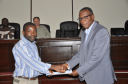Felix Uba receives certificate of participation from Provost Augustus Addy-Lamptey