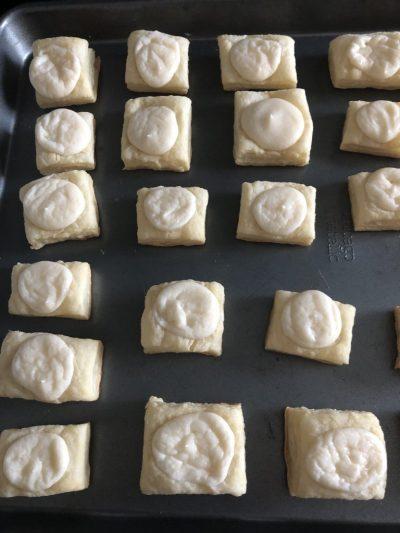 mini cream cheese danishes on baking sheet