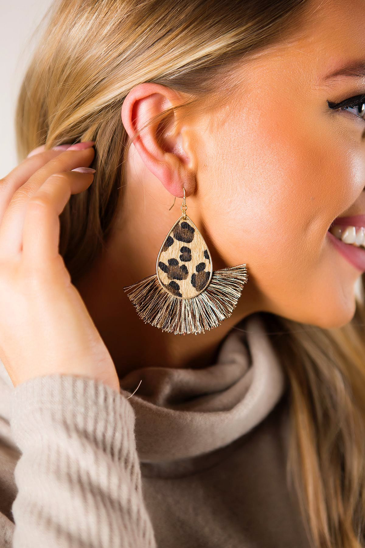 fan earrings with leopard print