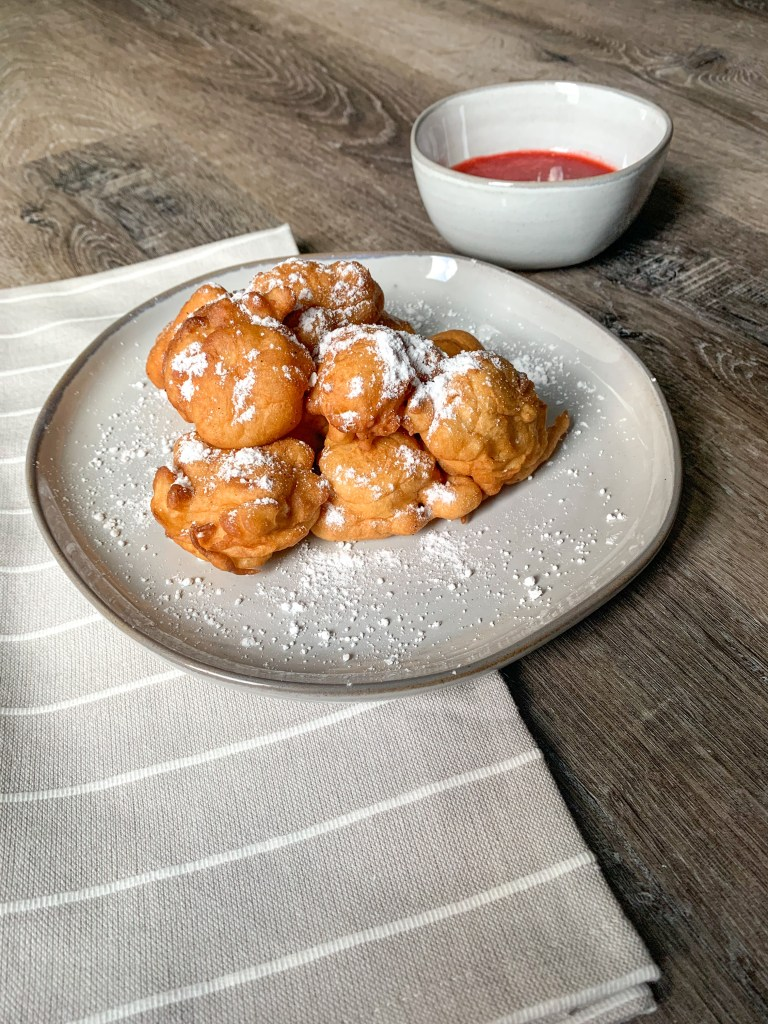 grey plate with stack of funnel cake bites
