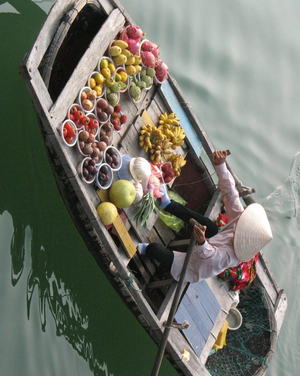 Boat fruit seller, Halong Bay, Vietnam