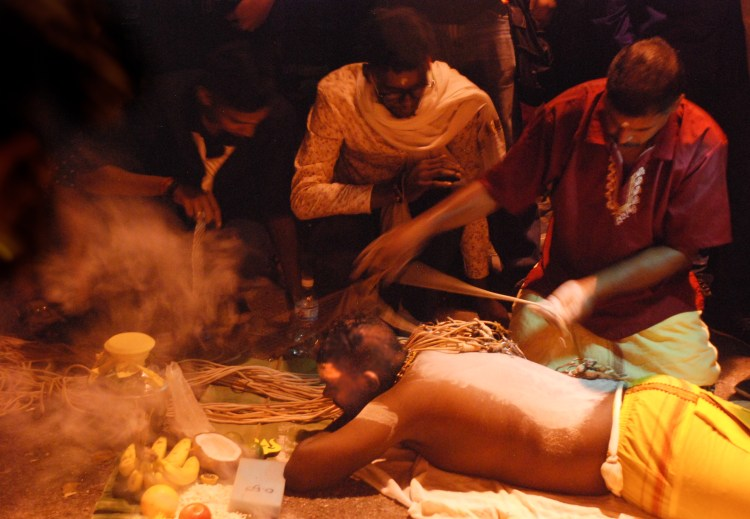 Participant lying down - Thaipusam in Penang