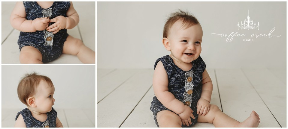 one year old session laughing on white background
