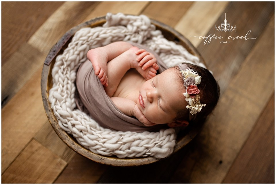 Indianapolis newborn photographer session baby girl in bowl with headband