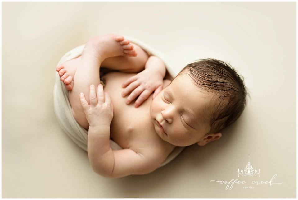 newborn baby boy on tan
