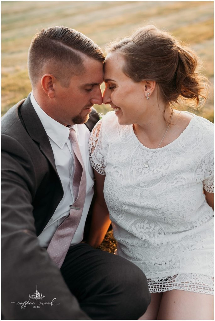 couple in sunset at barn venue wedding reception