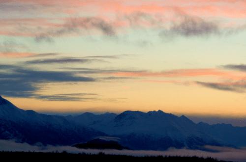 fog rising over boenburg butte in palmer, alaska