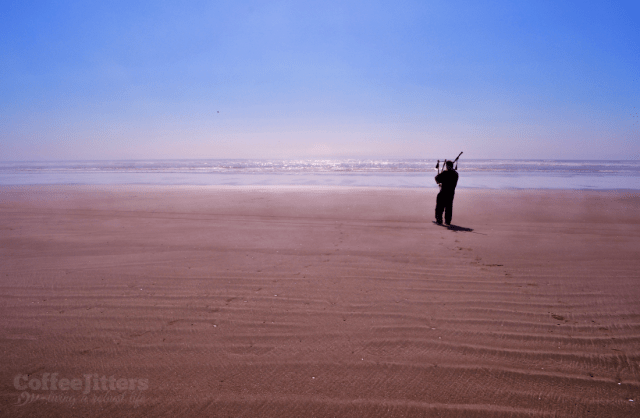bagpiper on the beach