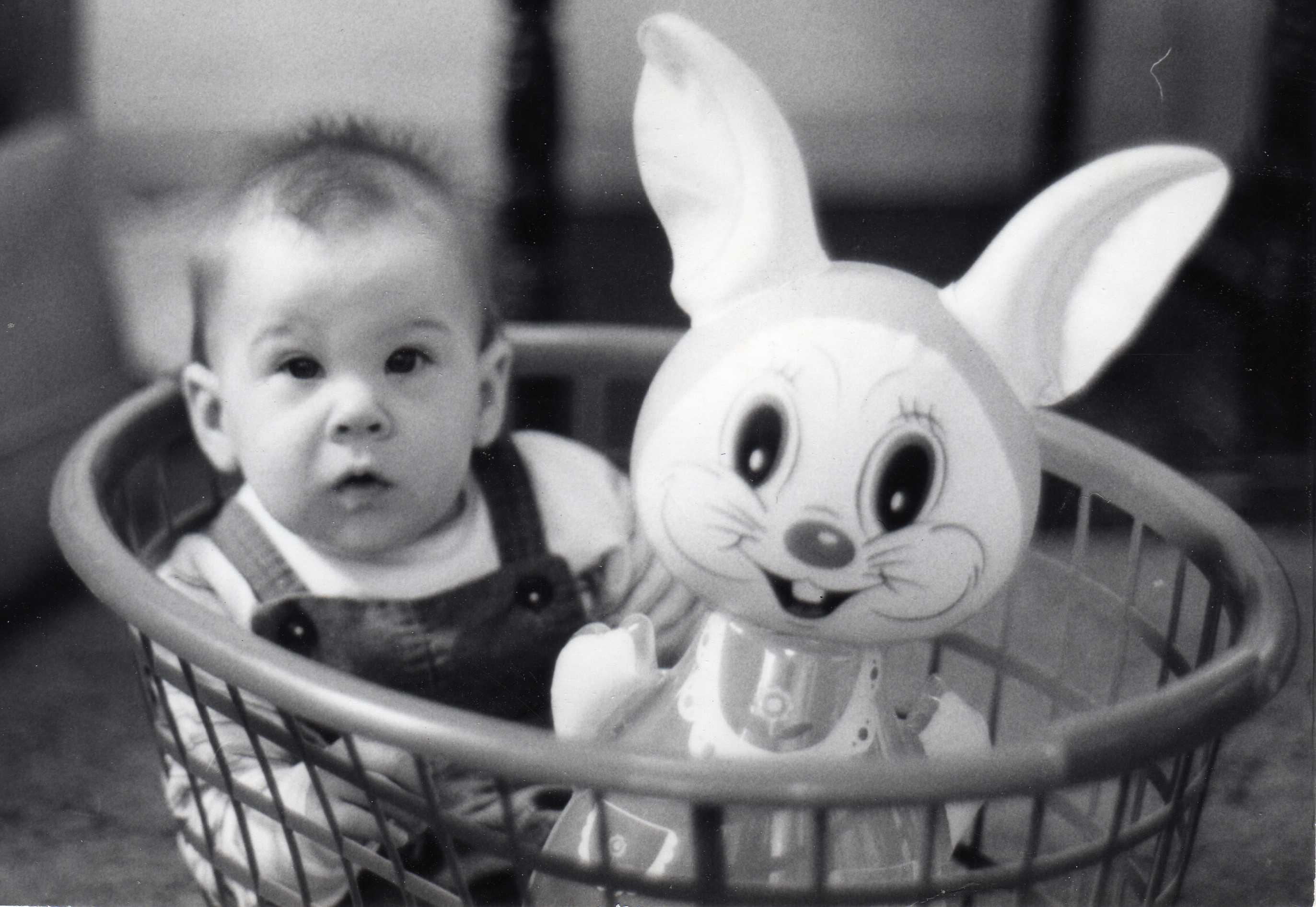 Kids in laundry baskets