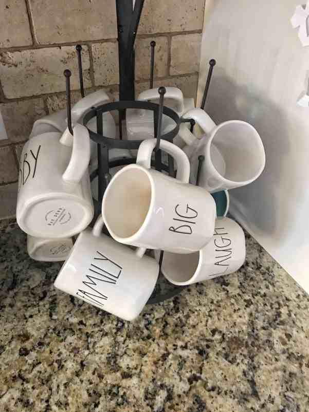 Use a mug rack to display Rae Dunn Mugs #raedunn #farmhousekitchen #farmhousedecor