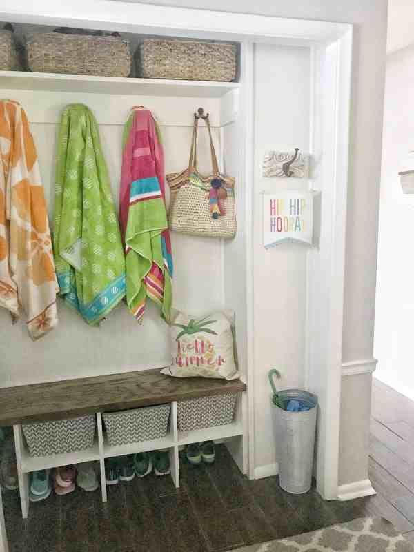 Organized summer towels in this former coat closet turned mud closet #smallspaces #organization #closets