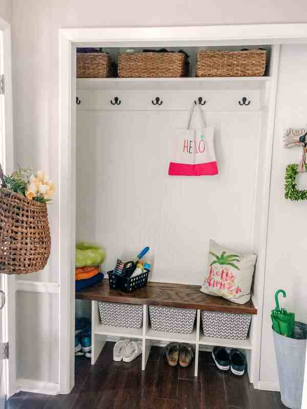 small mudroom with summer decor