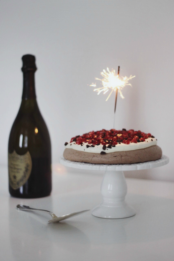 Pomegranate chocolate pavlova with sparkler