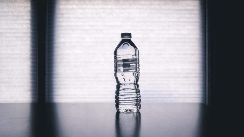 clear water bottle sitting on a table