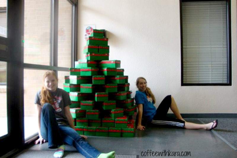 My friend, Colleen, and I with an OCC shoe box Christmas tree :)
