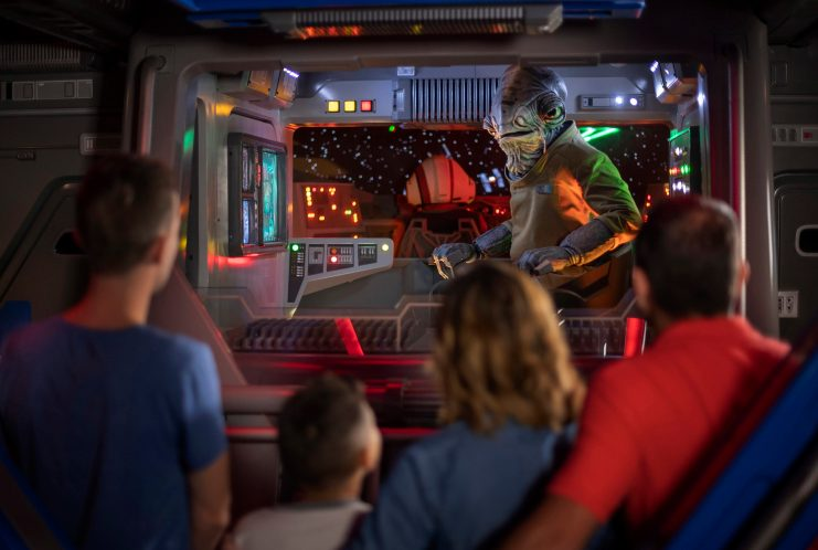 Lieutenant Bek, a Mon Calamari Resistance officer, speaks with guests aboard an Intersystem Transport Ship as they blast off Batuu in Star Wars: Rise of the Resistance, the groundbreaking new attraction opening Dec. 5, 2019, inside Star Wars: Galaxy's Edge at Disney's Hollywood Studios in Florida and Jan. 17, 2020, at Disneyland Park in California that takes guests into a climactic battle between the Resistance and the First Order. (Kent Phillips, photographer)