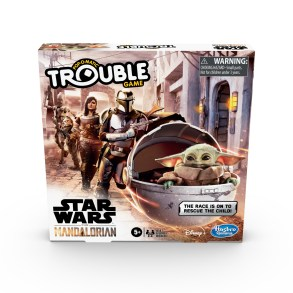 "TROUBLE: STAR WARS THE MANDALORIAN EDITION Game (HASBRO/Ages 5 years & up/Approx. Retail Price: $14.99/Available: Spring 2020) Inspired by the THE MANDALORIAN live-action TV series on Disney Plus, this TROUBLE: STAR WARS THE MANDALORIAN EDITION Game combines TROUBLE gameplay with THE MANDALORIAN adventures. Race around a dangerous planet in the outer reaches of the galaxy to rescue THE CHILD, who fans call ""BABY YODA"". Choose to play as bounty hunter, THE MANDALORIAN, IG-II the droid, the skilled warrior, CARA DUNE, or the vapor farmer, KUILL. The first player to get all 4 of their pawns to the Home space to rescue THE CHILD wins! This game makes a fun choice for Family Game Night and it's a great gift for STAR WARS THE MANDALORIAN fans. This game is for 2 to 4 players. Includes plastic game unit base with Pop-O-Matic die roller, cardboard gameboard insert, 16 plastic character pawns (4 of each color), label sheet, and instructions. Available at Amazon and Walmart."