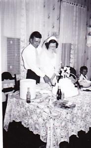 My grandparents cutting their wedding cake.