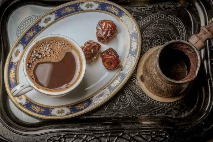 brewing coffee in cezve