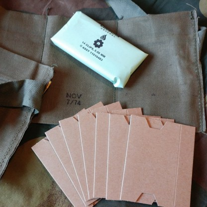 7 Pocket Bandoleer with cardboard and 14 clips