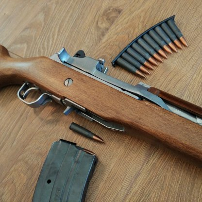 Wood and stainless Mini-30 with Tulammo and stripper clip