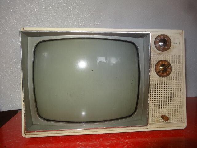 Old 1960s TV set, white dingy case.